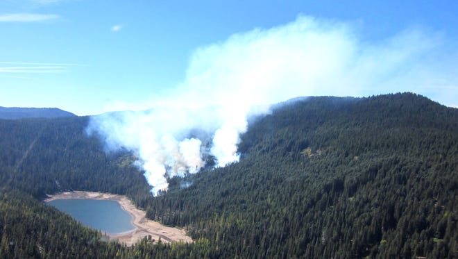 From its initial two acres when it first was spotted the Badger Fire has grown to about 60 acres.
