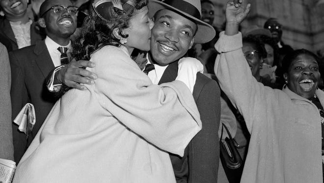 FILE - In this March 22, 1956, file photo, the Rev. Martin Luther King Jr. is welcomed with a kiss by his wife, Coretta, after leaving court in Montgomery, Ala. Court records from the arrests of Rosa Parks, Martin Luther King Jr. and others at the dawn of the modern civil rights era are being preserved after being discovered in an Alabama courthouse. (AP Photo/Gene Herrick, File)