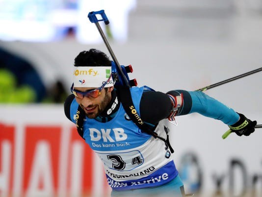 FILE - In this March 5, 2017, filephot, France's Martin Fourcade competes during the men's 4x7.5 km relay competition for the Biathlon World Cup at the Alpensia Biathlon Centre in Pyeongchang, South Korea. The double-gold medalist in 2014 finds summer training mentally taxing: Tough seeing friends and family leave for vacation while staying back to work.  (AP Photo/Lee Jin-man, File)