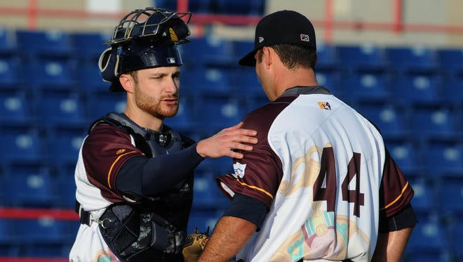 Jonathan Lucroy of the Milwaukee Brewers, on rehab assignment with the Brevard County Manatees, talks with starting pitcher Javier Salas during Thursday's game in Viera.