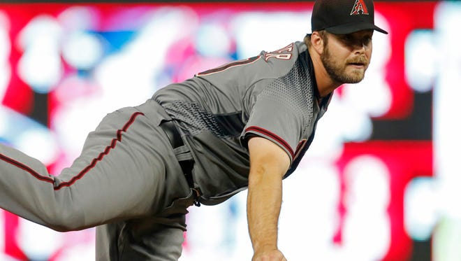 Arizona Diamondbacks relief pitcher J.J. Hoover throws against the Minnesota Twins in the sixth inning of a baseball game Saturday, Aug. 19, 2017, in Minneapolis. The Twins won 5-0. (AP Photo/Jim Mone)