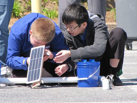 Middle school students design, build and race solar-powered cars during a competition in Harrington.