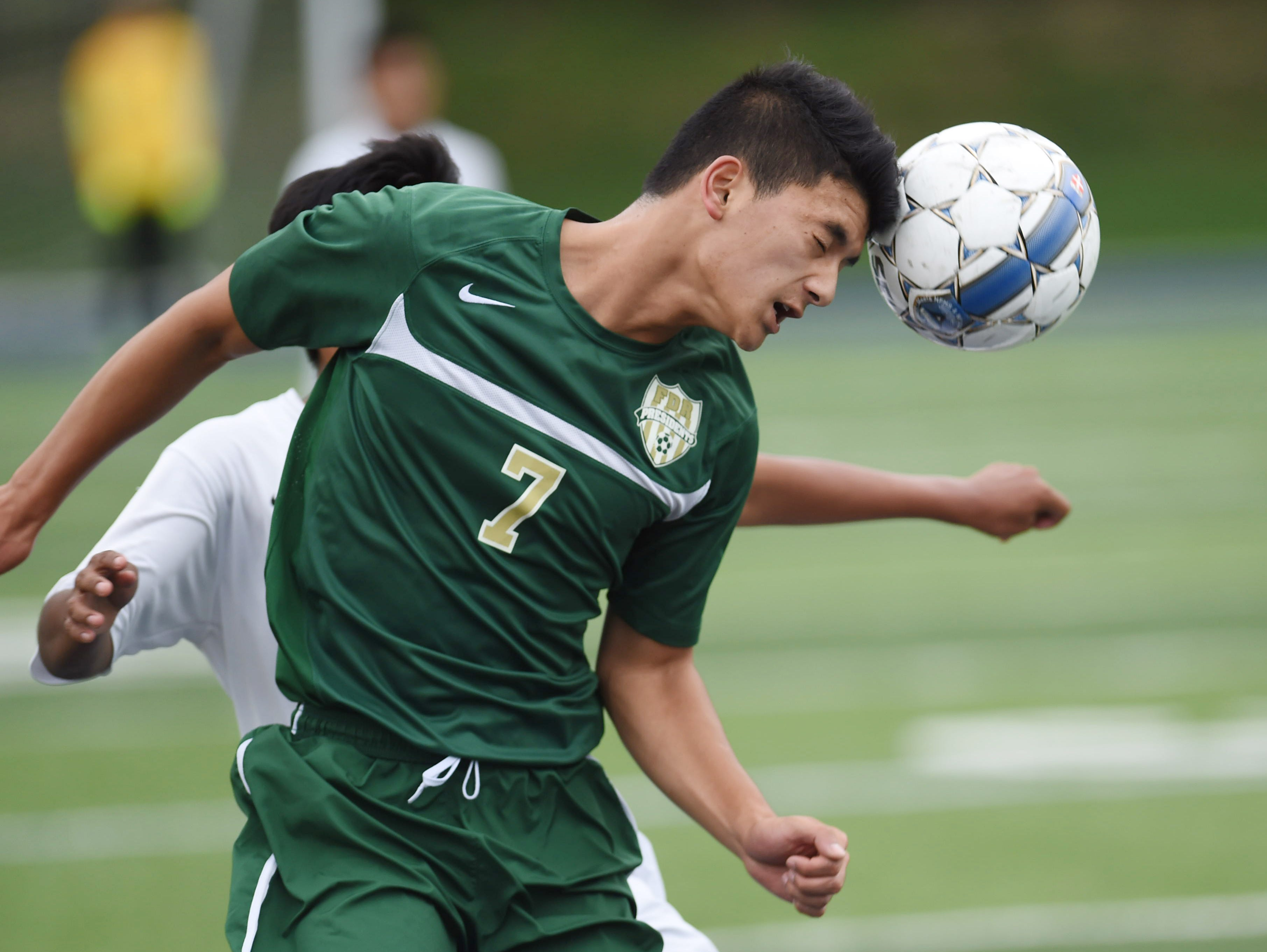 FDR's RJ Constantino headers the ball during Thursday's game versus Poughkeepsie High School in Poughkeepsie.