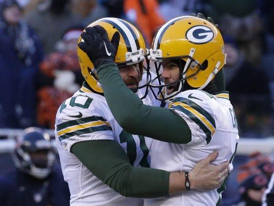 Packers kicker Mason Crosby celebrates with Jacob Schum after hitting the winning field goal against the Bears.