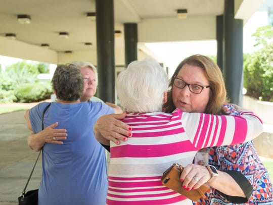 Patsy Binford, left, hugs Barbara Bartley Wednesday,