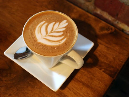 A latte at First Village Coffee at 123 Main Street in Ossining.