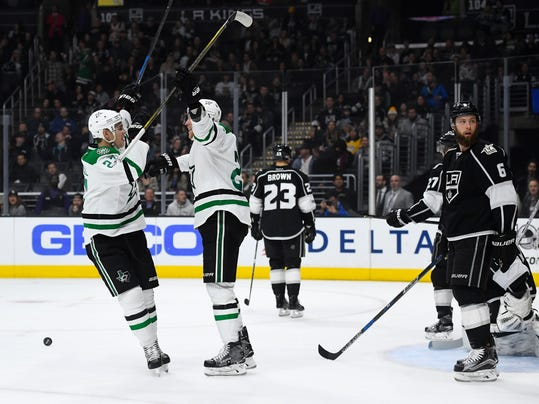 Dallas Stars right wing Brett Ritchie, second from left, celebrates his goal with right wing Adam Cracknell, left, as Los Angeles Kings defenseman Jake Muzzin, right, looks away during the first period of an NHL hockey game, Monday, Jan. 9, 2017, in Los Angeles. (AP Photo/Mark J. Terrill)