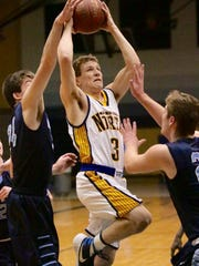Sheboygan North's Nate Winter goes up for a shot against