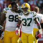 Packers nose tackle Letroy Guion (98) celebrates with cornerback Sam Shields (37) after Shields intercepted a pass from 49ers quarterback Colin Kaepernick during the second half.