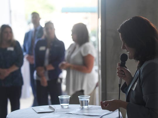 Amber Wertman, the executive director of United Way Marion, speaks to a crowd about the goals of the United Way campaign during a gathering at Marion General Hospital on Thursday evening.