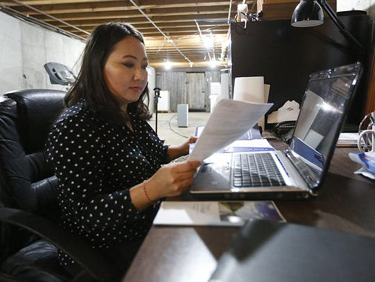 Ger Xiong of Oakfield works a part time business from