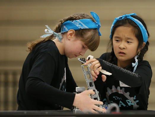 Sixth-graders Lily Pruzek, left, and Cynthia Yang of