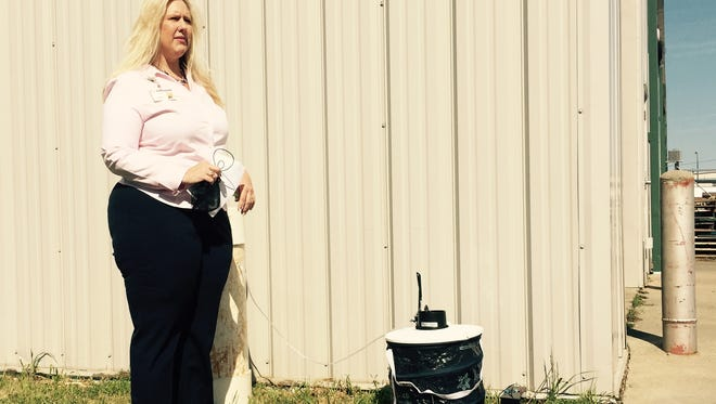Denise Patton, Sioux Falls Health Program Coordinator, stands next to one of three new mosquito traps designed to lure vectors most common during daylight hours.