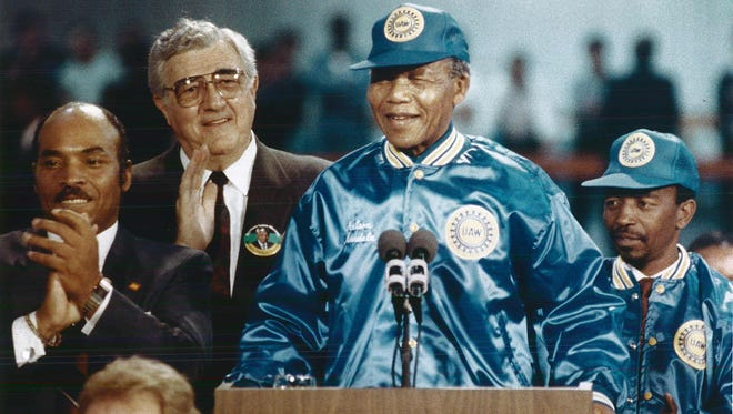 UAW International Vice President Ernie Lofton (left) and UAW President Owen Bieber stand with Nelson Mandela at the Ford Rouge complex in June 1990.