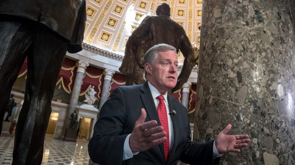 Rep. Mark Meadows, R-Buncombe, speaks during a television news interview just before passage of the Republican tax reform bill in the House of Representatives, on Capitol Hill, in Washington Tuesday.