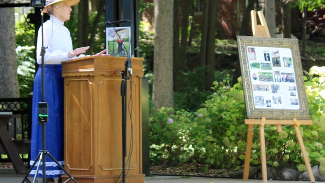 JoAnne Miller of the Hillsdale County Historical Society offers some remembrances of Sally Fallon during a tribute to her in Mrs. Stock's Park Tuesday.