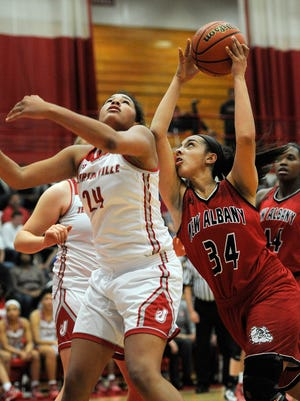 New Albany's Savanna Pinkston (34) runs into Jeffersonville's Nan Garcia (24) as she drives for the basket on Friday at Jeffersonville High School. Jan.20, 2017