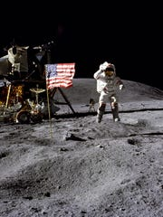FILE- In this April 1972 photo made available by NASA, John Young salutes the U.S. flag at the Descartes landing site on the moon during the first Apollo 16 extravehicular activity. America's next moon landing will be made by private companies, not NASA. NASA Administrator Jim Bridenstine announced Thursday, Nov. 29, 2018, that nine U.S. companies will compete in delivering experiments to the lunar surface. (Charles M. Duke Jr./NASA via AP, File)