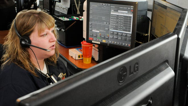 Dispatcher Nicole Behrmann dispatches a Manitowoc County Sheriff's deputy to a disabled vehicle call at the Manitowoc County Dispatch Center in Manitowoc.