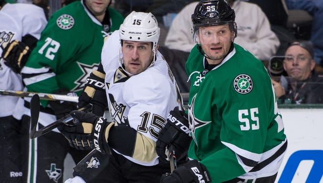 Dallas Stars defenseman Sergei Gonchar (55) defends against Pittsburgh Penguins left wing Tanner Glass (15) during the first period at the American Airlines Center.