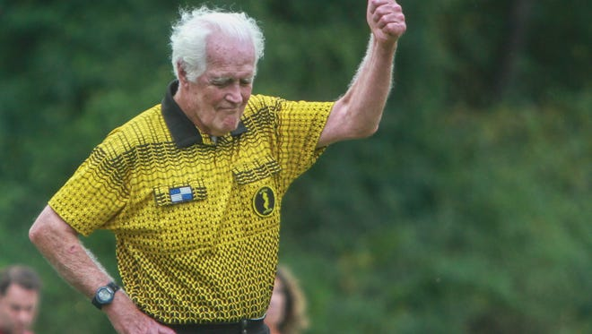 Manalapan, NJ    86 year old soccer referee Jim Grimes in action officiating a game at Manalapan-Englishtown Middle School .092915 Photo Tom Spader/Gannett