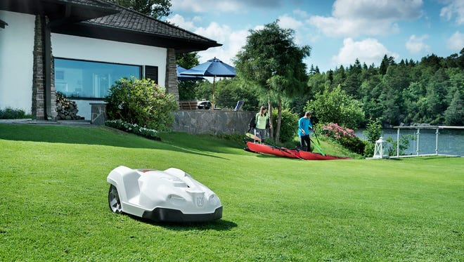 """Sweden's Husqvarna offers some of the more unusual """"green"""" lawn mowers on the market: its Automower series. You've heard about the Roomba, the robotic vacuum that tools around your house cleaning your floors? The Automowers are Roomba's lawn-mowing equivalent.The model shown here is the Husqvarna Automower 330 X."""