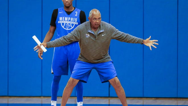 Memphis coach Tubby Smith (right) works with guard Jeremiah Martin during their first practice of the 2017-18 season on Sept. 29, 2017, at the Larry O. Finch Center.