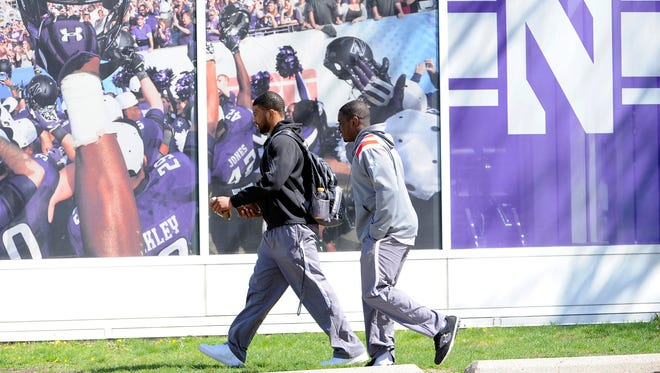 Northwestern football players Chi Chi Ariguzo, left, and Traveon Henry go Friday to vote on whether to unionize.