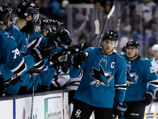 San Jose Sharks center Joe Pavelski, right, celebrates his goal with teammates during the first period of an NHL hockey game Sunday, Feb. 18, 2018, in San Jose, Calif. (AP Photo/Marcio Jose Sanchez)