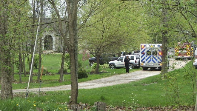 Police and paramedics respond to the home of the Reitter family in May 2019.