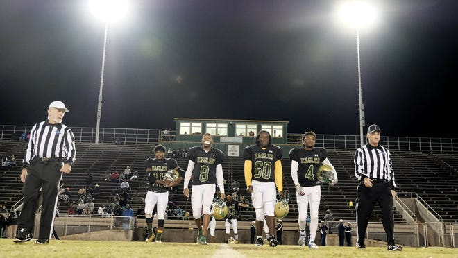FILE - Josey players walk out for the coin toss looking for a win against cross town rivals Laney at the high school football game between Laney and TW Josey in Augusta, GA, Friday, November, 8  2019.