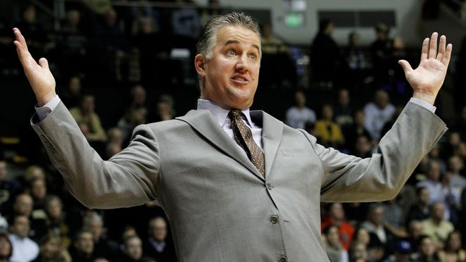 Coach Matt Painter reacts to a four call against the Boilermaker as they battle Gardner-Webb Monday, December 22, 2014, at Mackey Arena on the campus of Purdue University. Gardner-Webb shocked Purdue, winning 89-84.