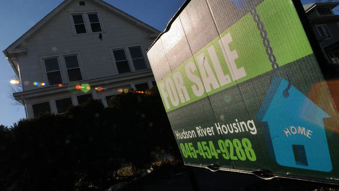 This file photo shows a house for sale in the City of Poughkeepsie.