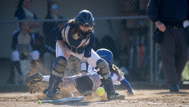 Alexis Nix slides home safely during an April 12 nonconference game against Roberson in Marshall.