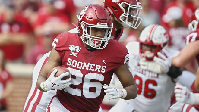 Oklahoma running back Kennedy Brooks (26) carries during an NCAA college football game against Texas Tech in Norman, Okla., Saturday, Sept. 28, 2019.