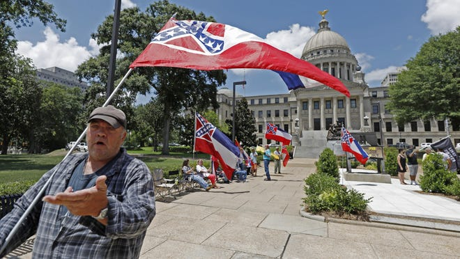 """I love this flag,"" states David Flynt of Hattiesburg, while standing outside the state Capitol with other current Mississippi flag supporters in Jackson, Miss., Sunday, June 28, 2020."