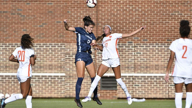 Abby Allen, center left, rises for a header during her first collegiate start for North Carolina on Oct. 1 against Clemson. The freshman center back from Austin has excelled for the No. 1-ranked team in the country.