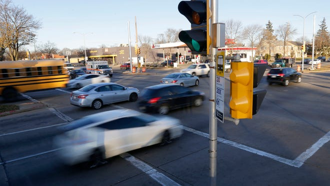 Motorists on West Capitol Drive looking northwest at North Sherman Boulevard: Would helping motorists get their driver's licenses back make them more responsible? Three Milwaukee judges think it might and have launched a program to help.