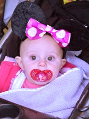 Seven-month-old McKinley Coldren is ready for her first