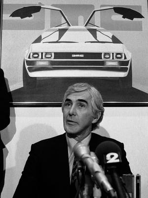 John Z. DeLorean of the DeLorean Motor Car Co. holds press conference at his Park Avenue office on the restructuring of his company on Feb. 19, 1982. Behind is photo car bearing his name. In 2014, the widow of automaker John DeLorean sued a Texas company she said has been illegally using the DeLorean name for years.
