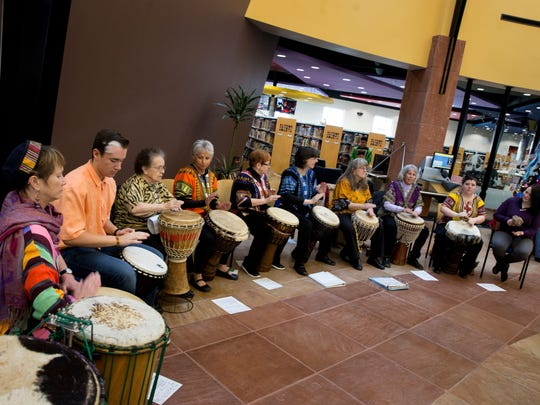 The Ashay Drummers perform during the winter solstice celebration onDec. 21, 2017, at the Farmington Public Library.