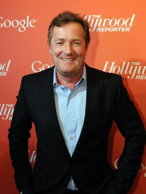 In a file picture taken on April 27, 2012 CNN's Piers Morgan arrives at a red carpet event hosted by Google and the Hollywood Reporter on the eve of the annual White House Correspondents Association dinner in Washington.