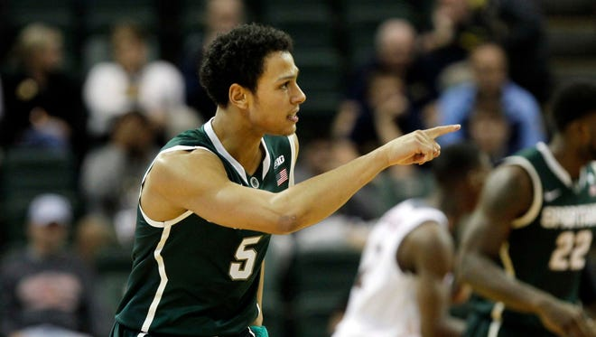 Michigan State Spartans guard Bryn Forbes (5) points after he made a three pointer against the Rider Broncs during the first half at HP Field House.