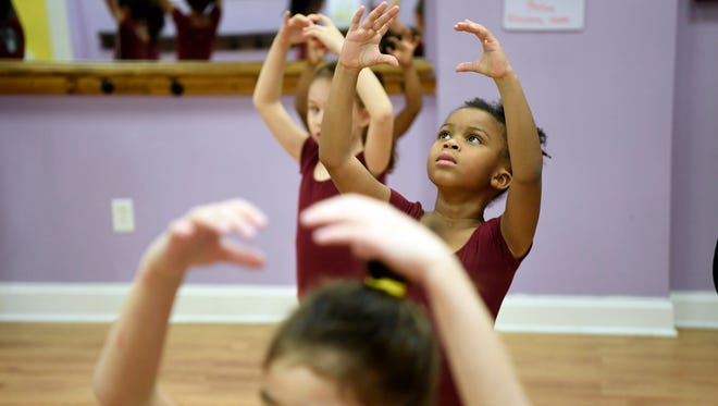 Girls practicing their Christmas concert routine during a ballet class at Blossom Sisters Dance and Performing Arts in Hackensack.