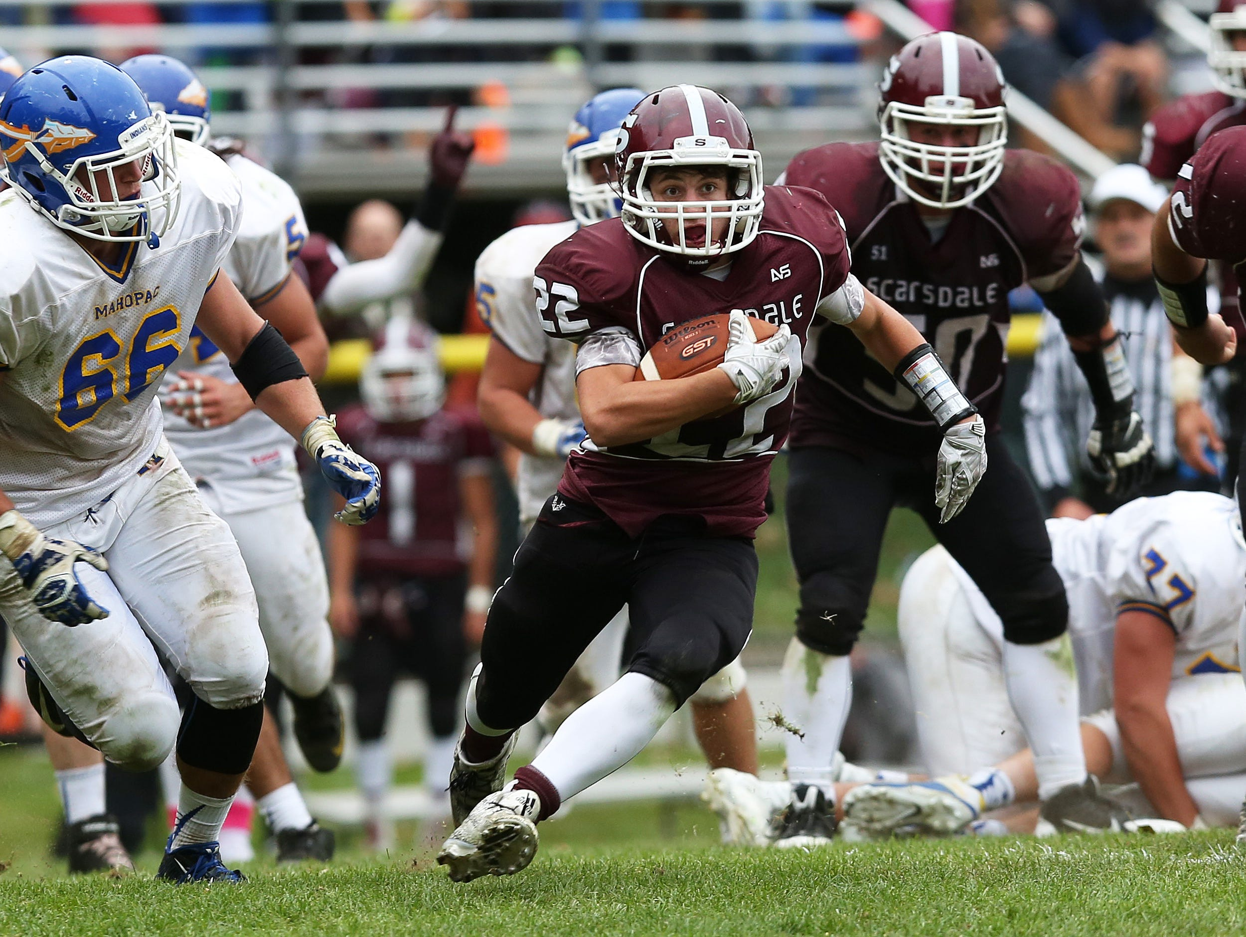 Scarsdale's Nick Leone (22) breaks free on a second half touchdown run against Mahopac during football playoff game at Scarsdale High School Oct. 24, 2015. Scarsdale won the game 33-28.