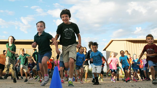J. Paul Taylor Academy students participate in the school's Running Club on a recent morning. The club encourages kids to exercise by making running a fun activity.