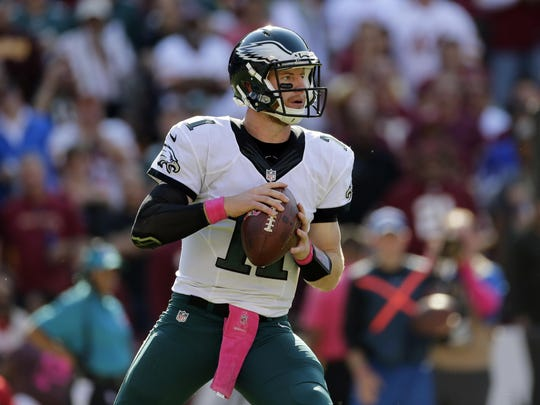 Philadelphia Eagles quarterback Carson Wentz looks for a receiver Oct. 16 against the Washington Redskins in Landover, Md.