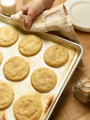 This photo provided by the Culinary Institute of America shows Snickerdoodle cookies in Hyde Park, N.Y. The sugar cookies is rolled in cinnamon-sugar before being baked.