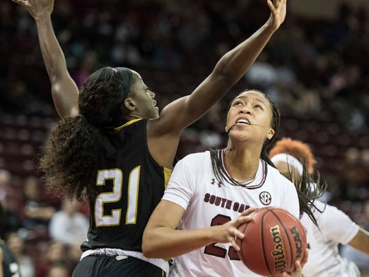 South Carolina forward Ladazhia Williams, right, attempts a shot against Alabama State forward Nia Snapp (21) during the second half of an NCAA college basketball game Friday, Nov. 10, 2017, in Columbia, S.C.  (AP Photo/Sean Rayford)