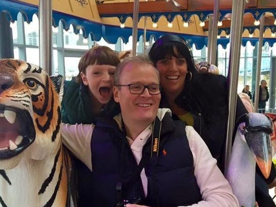 Reporters Sharon and Alex Coolidge enjoy Carol Ann's Carousel at Smale Riverfront Park with son Jack.